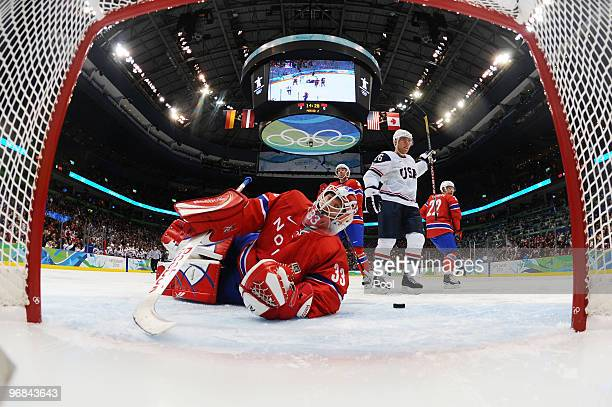 Goalie Pal Grotnes of Norway looks back into the goal after giving up a score during the ice hockey men's preliminary game between USA and Norway on...