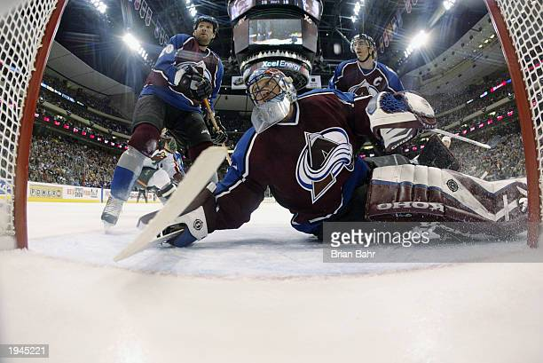 Goalie Patrick Roy of the Colorado Avalanche follows the puck as it flies behind the goal against the Minnesota Wild during game four of the first...