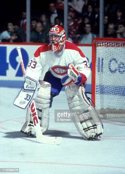Goalie Patrick Roy of the Montreal Canadiens defends the net during an NHL game circa 1994 at the Montreal Forum in Montreal Quebec Canada