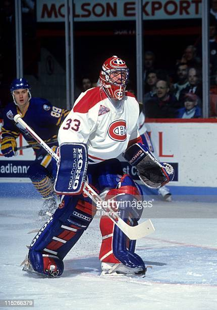Goalie Patrick Roy of the Montreal Canadiens defends the net during an NHL game against the Buffalo Sabres circa 1990 at the Montreal Forum in...