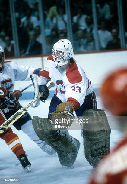 Goalie Patrick Roy of the Montreal Canadiens gloves the puck during an NHL game against the Calgary Flames circa 1986 at the Montreal Forum in...