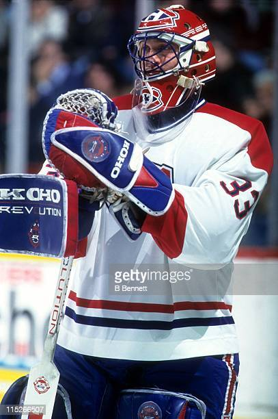 Goalie Patrick Roy of the Montreal Canadiens looks on during an NHL game in February 1995 at the Montreal Forum in Montreal Quebec Canada