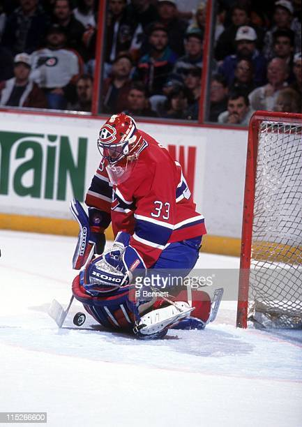Goalie Patrick Roy of the Montreal Canadiens makes the save during an NHL game against the Philadelphia Flyers on March 20 1995 at the Spectrum in...