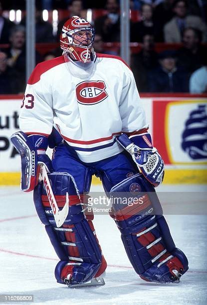 Goalie Patrick Roy of the Montreal Canadiens skates on the ice during an NHL game in April 1995 at the Montreal Forum in Montreal Quebec Canada