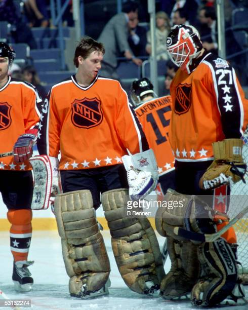 Goalie Patrick Roy of the Wales Conference and the Montreal Canadiens talks with teammate and goalie Ron Hextall of the Philadelphia Flyers during...