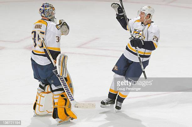 Goalie Pekka Rinne and Patric Hornqvist of the Nashville Predators celebrate their 41 victory over the Colorado Avalanche at the Pepsi Center on...