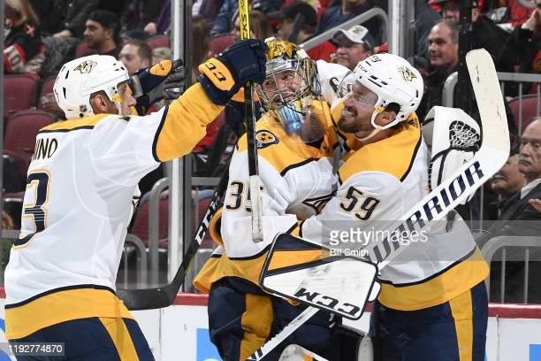 Goalie Pekka Rinne and Roman Josi of the Nashville Predators hug after scoring an emptynet goal in the third period at the United Center on January 9...
