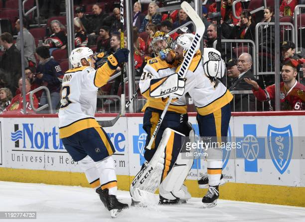 Goalie Pekka Rinne and Roman Josi of the Nashville Predators hug after the Predators scored an emptynet goal in the third period at the United Center...