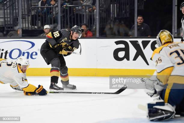 Goalie Pekka Rinne makes a save while his Nashville Predators teammate Anthony Bitetto defends Tomas Nosek of the Vegas Golden Knights during the...