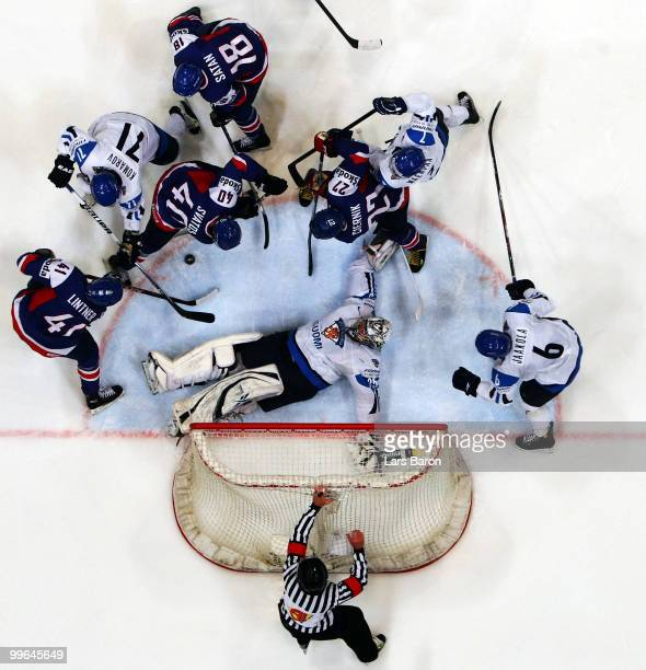 Goalie Pekka Rinne of Finland is challenged by Richard Lintner Marek Svatos Miroslav Satan and Ivan Ciernik of Slovakia during the IIHF World...