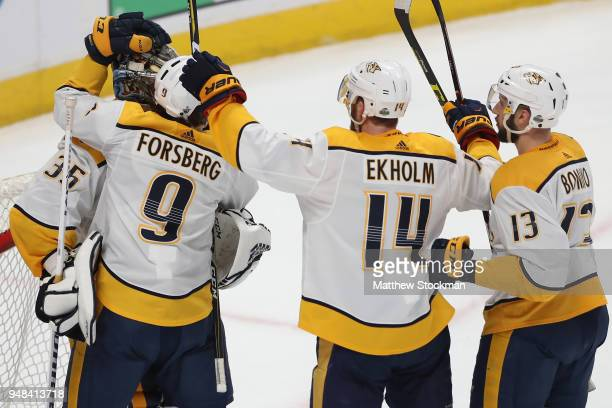 Goalie Pekka Rinne of the Nashville Predators is congratulated by teammates Filip Forsberg Mattias Elkholm and Nick Bonino after a 32 win against the...