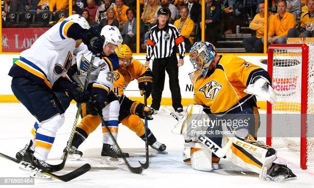 Goalie Pekka Rinne of the Nashville Predators makes a save against Vladimir Tarasenko of the St Louis Blues during the second period of Game Four of...