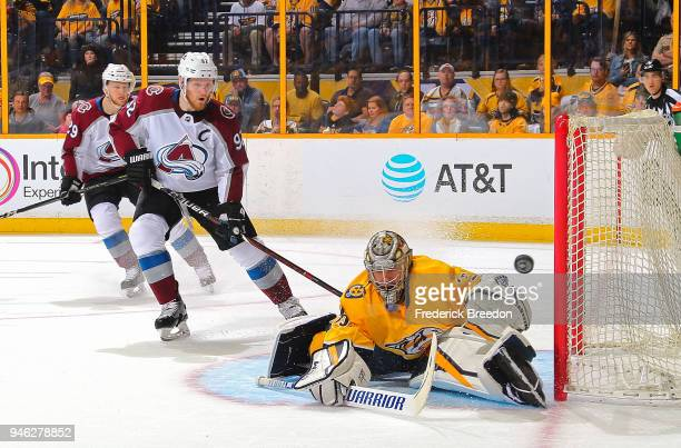 Goalie Pekka Rinne of the Nashville Predators makes a save on a shot by Gabriel Landeskog of the Colorado Avalanche during the first period in Game...