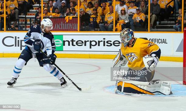 Goalie Pekka Rinne of the Nashville Predators makes a save on a shot by Kyle Connor of the Winnipeg Jets during the second period in Game Two of the...