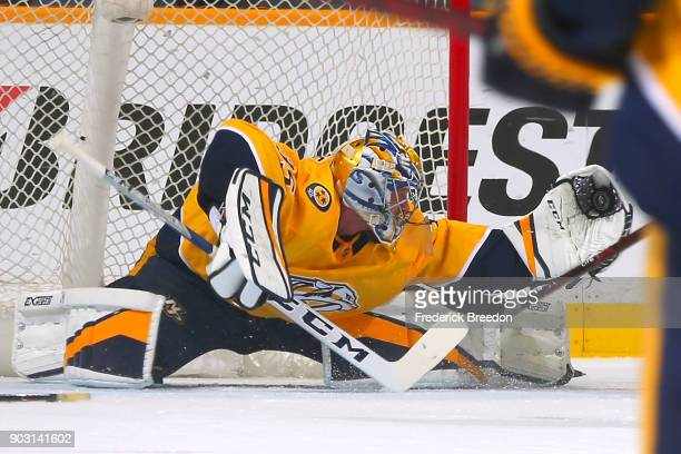 Goalie Pekka Rinne of the Nashville Predators stretches to make a save on a breakaway shot during the first of a game against the Edmonton Oilers...