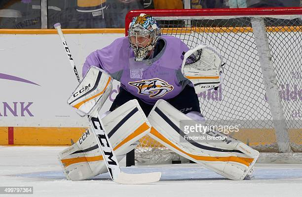 Goalie Pekka Rinne of the Nashville Predators wears a Hockey Fights Cancer jersey during warm ups prior to a game against the St Louis Blues at...