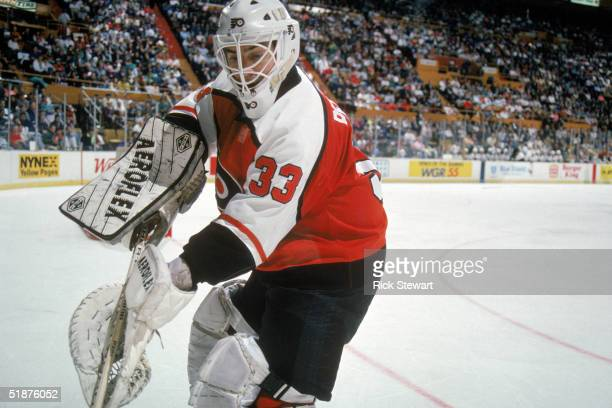 Goalie Pete Peeters of the Philadelphia Flyers plays the puck from the corner of the ice rink during a game against the Buffalo Sabres in the...