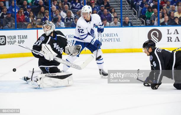 Goalie Peter Budaj and Anton Stralman of the Tampa Bay Lightning watch the puck fly into the net for a goal for Tyler Bozak and the Toronto Maple...