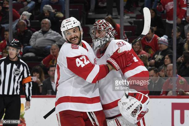 Goalie Petr Mrazek and Martin Frk of the Detroit Red Wings celebrate after defeating the Chicago Blackhawks 40 at the United Center on January 14...
