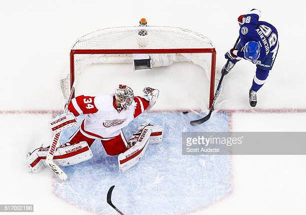Goalie Petr Mrazek stretches but can't make the save as Nikita Kucherov of the Tampa Bay Lightning shoots the puck into the net for a goal during the...