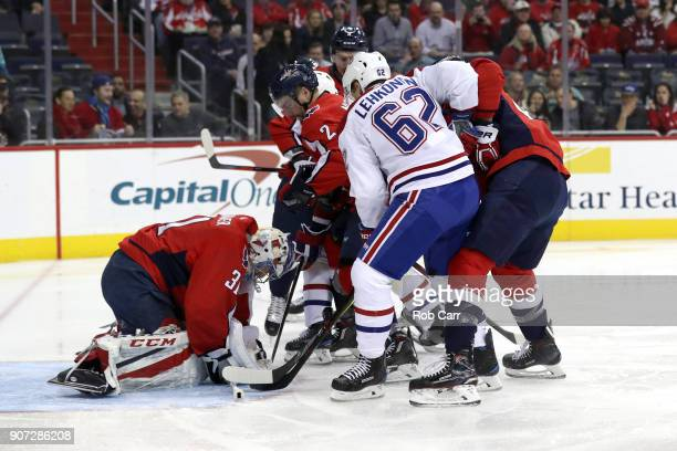 Goalie Philipp Grubauer of the Washington Capitals covers the puck against the Montreal Canadiens in the first period at Capital One Arena on January...