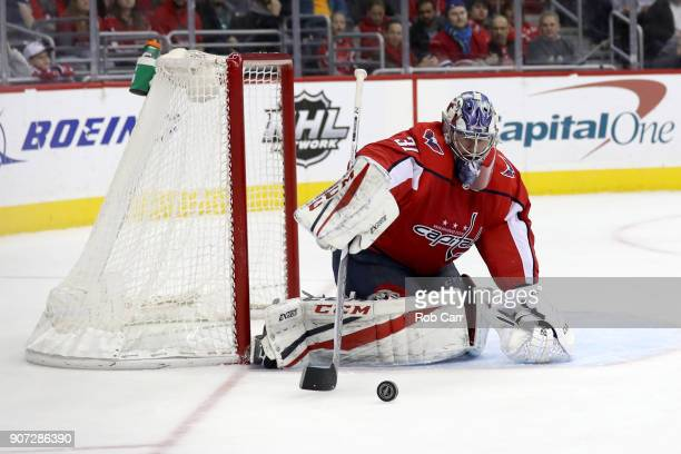 Goalie Philipp Grubauer of the Washington Capitals deflects the puck against the Montreal Canadiens in the first period at Capital One Arena on...