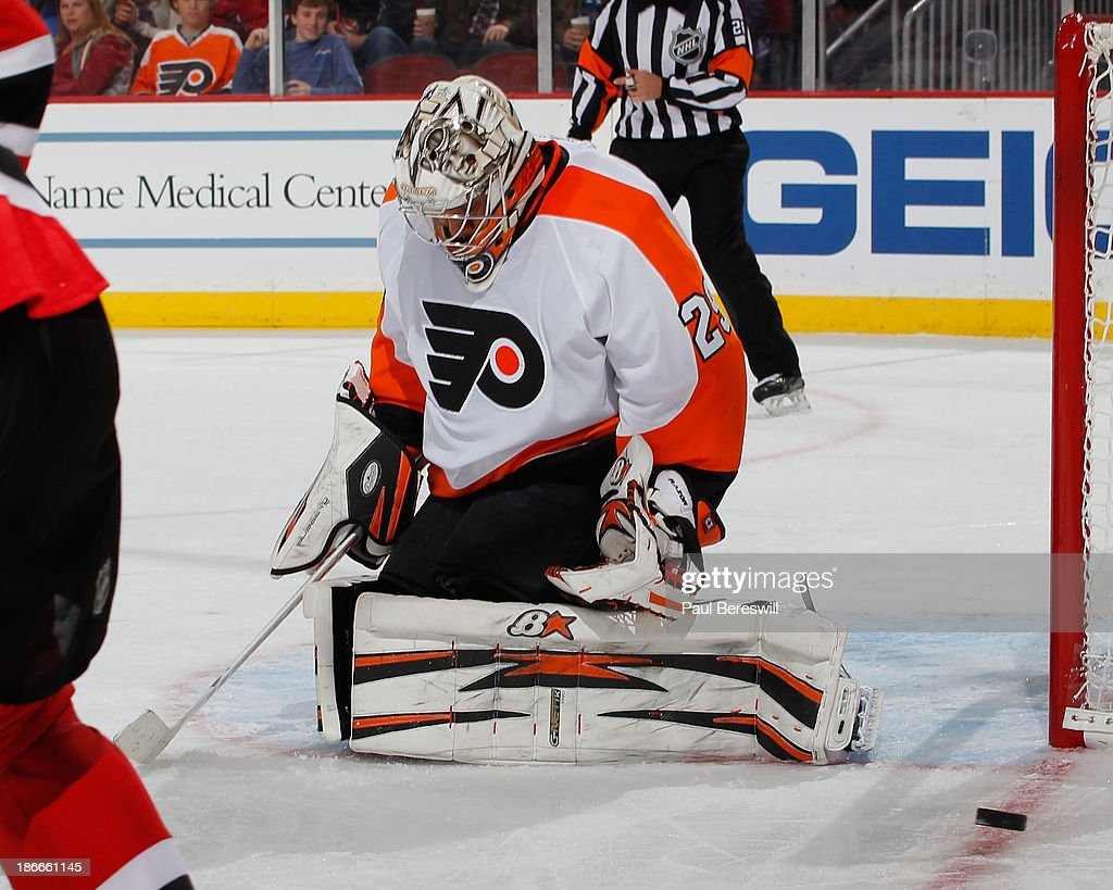 Goalie Ray Emery #29 of the Philadelphia Flyers makes a save against the New Jersey Devils during the second period of an NHL hockey game at Prudential Center on November 2, 2013 in Newark, New Jersey.