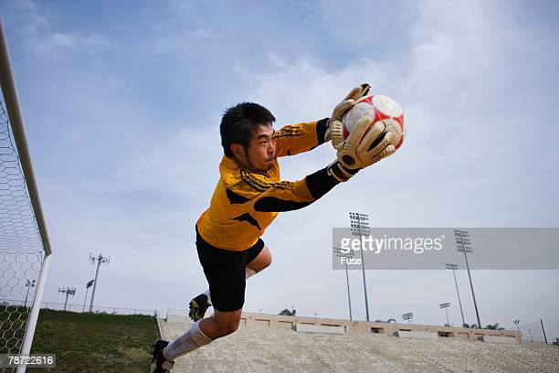 goalie reaching to save a goal - making a save sports stock pictures, royalty-free photos & images