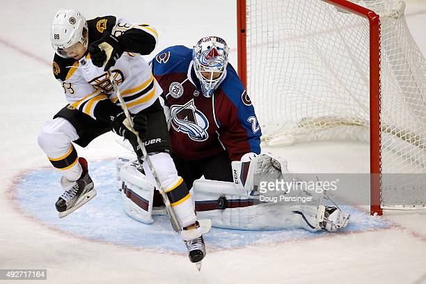 Goalie Reto Berra of the Colorado Avalanche makes a save a David Pastrnak of the Boston Bruins looks for the rebound at Pepsi Center on October 14...