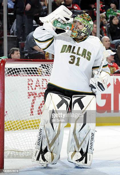 Goalie Richard Bachman of the Dallas Stars takes a drink during the NHL game against the Chicago Blackhawks on February 23 2012 at the United Center...