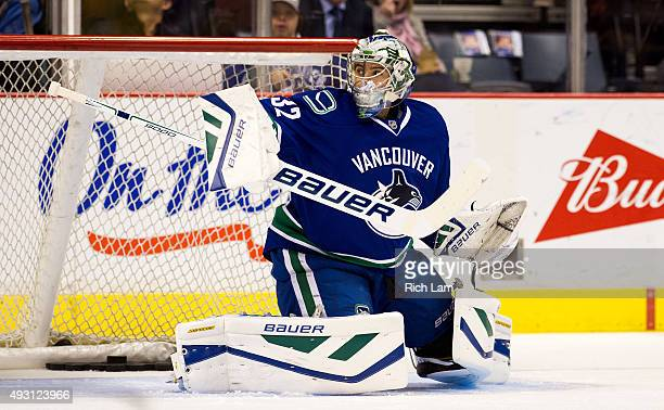 Goalie Richard Bachman of the Vancouver Canucks makes a save during the pregame warm up prior to the start of NHL action against the Calgary Flames...