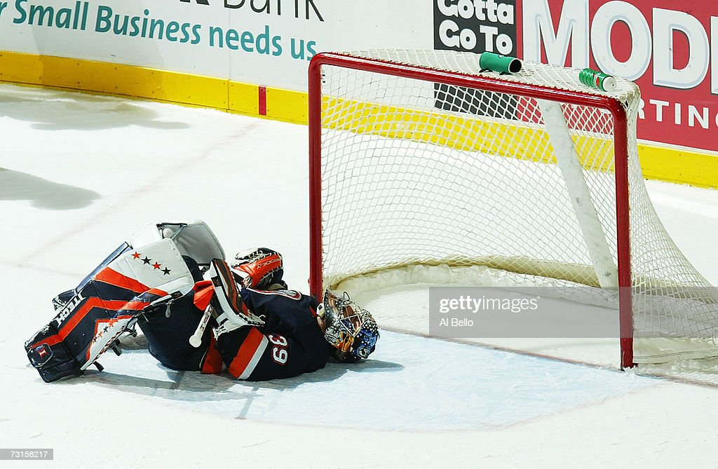Goalie Rick DiPietro #39 of the New York Islanders sits defeated after giving up the winning overtime goal by Henrik Zetterberg #40 of the Detroit Red Wings during their game on January 30, 2007 at the Nassau Coliseum in Uniondale, New York.