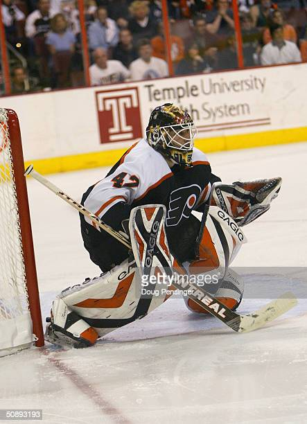 Goalie Robert Esche of the Philadelphia Flyers protects the net from the New Jersey Devils during game five of the quarterfinals of the Stanley Cup...