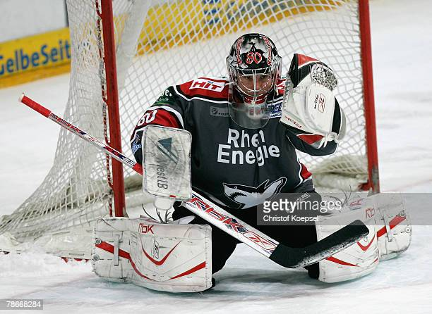 Goalie Robert Mueller of the Haie saves the puck during the DEL game between Koelner Haie and Hamburg Freezers at the Koelnarena on December 28 2007...