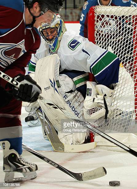 Goalie Roberto Luongo of the Canucks defends the goal a Matt Duchene of the Colorado Avalanche controls the puck at the Pepsi Center on January 18...