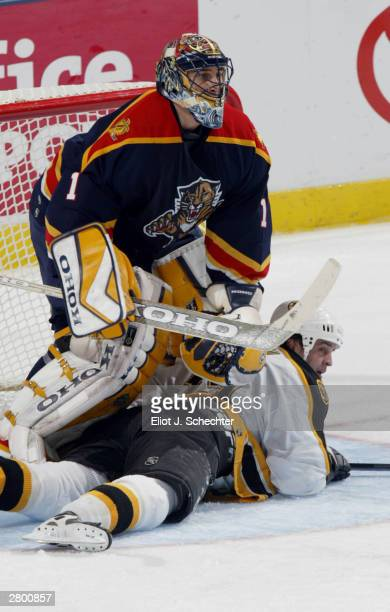 Goalie Roberto Luongo of the Florida Panthers tangles with Center Travis Green of the Boston Bruins in NHL action on December 10, 2003 at the Office...
