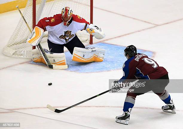 Goalie Roberto Luongo of the Florida Panthers turns away a shot by Matt Duchene of the Colorado Avalanche at Pepsi Center on October 21 2014 in...