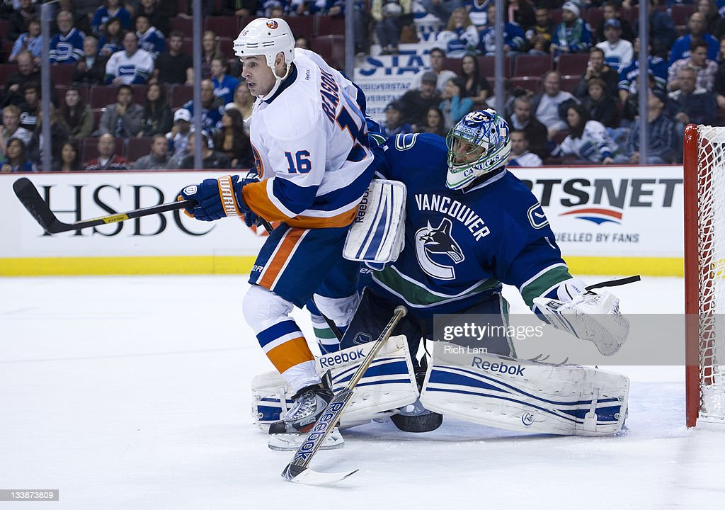 Goalie Roberto Luongo Of The Vancouver Canucks Gets Bumped By Marty