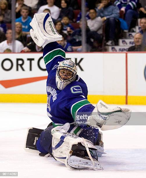 Goalie Roberto Luongo of the Vancouver Canucks reaches out to make a glove save during the third period of NHL action against the Chicago Blackhawks...