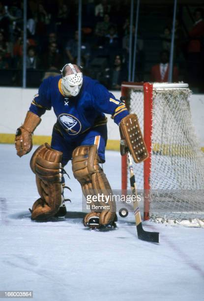 Goalie Roger Crozier of the Buffalo Sabres plays the puck during an NHL game against the Washington Capitals circa 1975 at the Capital Centre in...