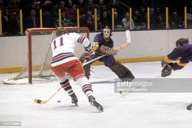 Goalie Rogie Vachon of the Los Angeles Kings looks to make the save on Vic Hadfield of the New York Rangers circa 1972 at the Madison Square Garden...