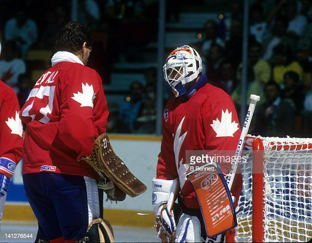 Goalie Ron Hextall of Team Canada talks with goalie Grant Fuhr before their game against Team USSR in the 1987 Canada Cup in September 1987 at the...