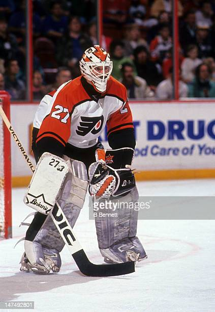 Goalie Ron Hextall of the Philadelphia Flyers defends the net during an NHL game in December 1990 at the Spectrum in Philadelphia Pennsylvania