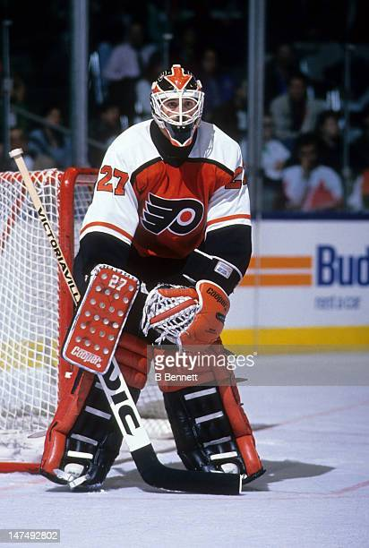 Goalie Ron Hextall of the Philadelphia Flyers defends the net during an NHL game in March 1991