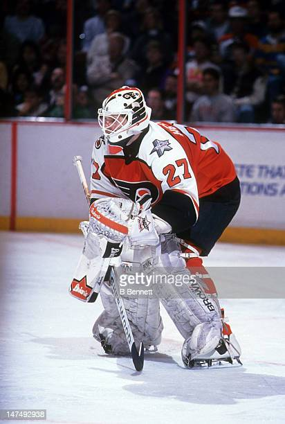 Goalie Ron Hextall of the Philadelphia Flyers defends the net during an NHL game circa 1992