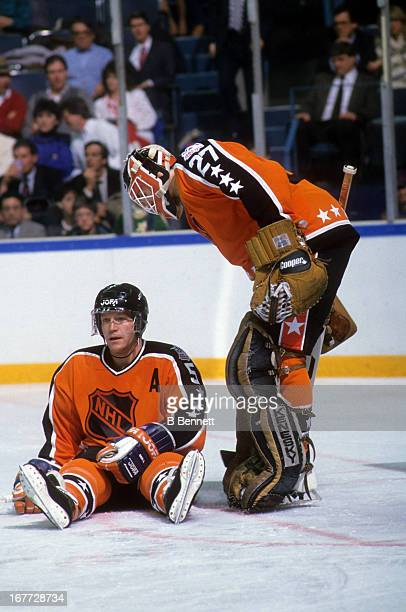 Goalie Ron Hextall of the Wales Conference and the Philadelphia Flyers talks to Denis Potvin of the Wales Conference and the New York Islanders...