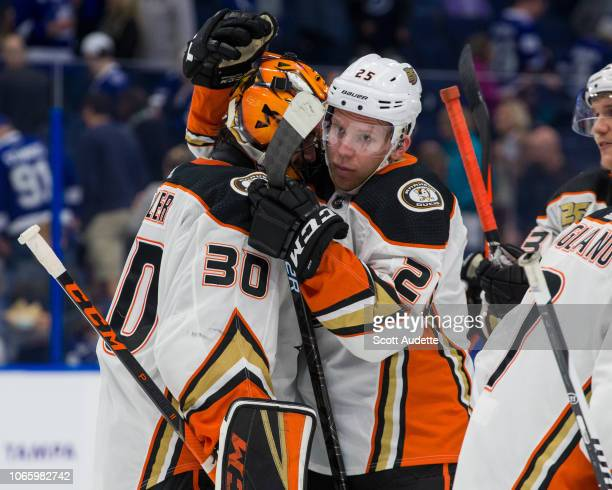 Goalie Ryan Miller of the Anaheim Ducks celebrates the win with teammate Ondrej Kase against the Tampa Bay Lightning at Amalie Arena on November 27...