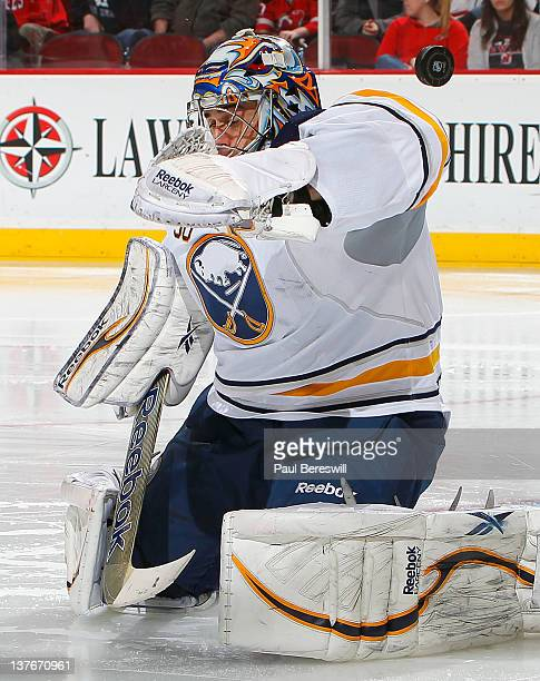 Goalie Ryan Miller of the Buffalo Sabres makes a save against the New Jersey Devils during the second period of an NHL hockey game at Prudential...