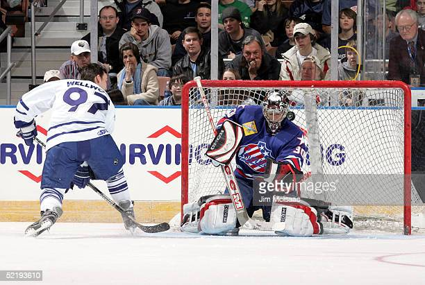 Goalie Ryan Miller of the Rochester Americans makes a save against center Kyle Wellwood of the St John's Maple Leafs during the breakaway relay at...