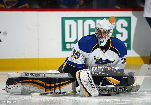 Goalie Ryan Miller of the St Louis Blues stretches during warm ups prior to facing the Colorado Avalanche at Pepsi Center on March 8 2014 in Denver...
